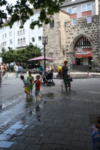 Water and playground fun in front of one of Bonn's old city gates.