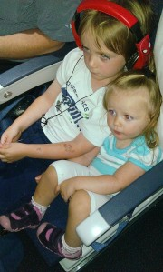 My 4 year old and my 18 month old watching a movie together on the plane.