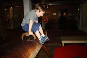 Playing on an old pommel horse at the German Sports & Olympic Museum.