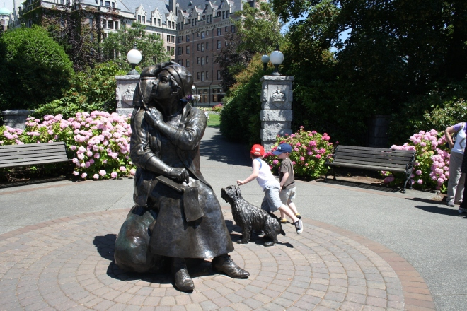 Playing on the Emily Carr monument in front of the Fairmont Empress Hotel.