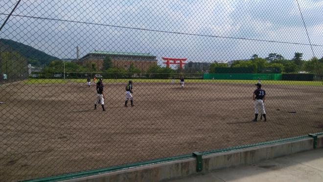 Watching a baseball practice.