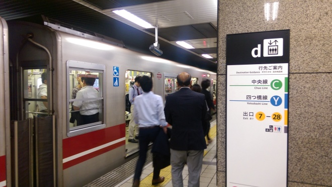 They try to give foreigners some direction in bigger cities. Subway, Osaka, Japan.