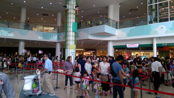 The crowd to get into Kidzania.