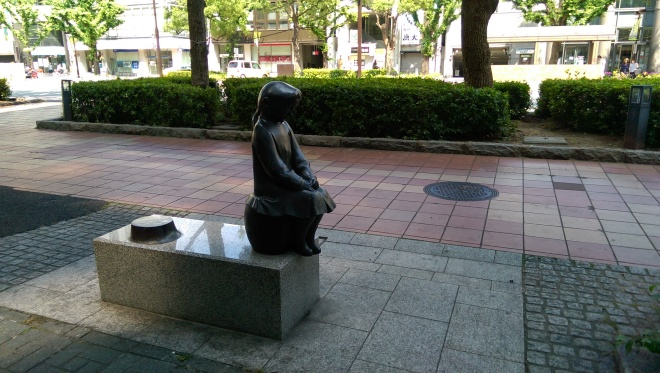 One of many statues that line the street from Himeji station to the castle.
