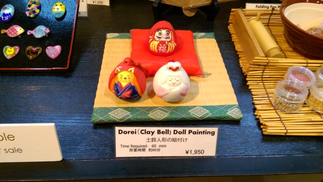 Doll bells at the craft sample table.  Kyoto Handicraft Center.