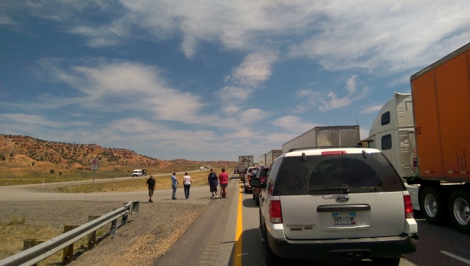People gather out of their cars, on  the road, as we wait for an accident about a mile ahead to be cleared.