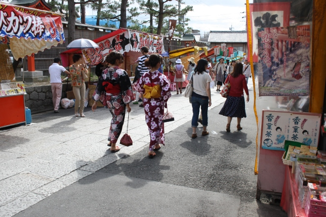 Walking from the train station to the main shrines and temple. Inari.